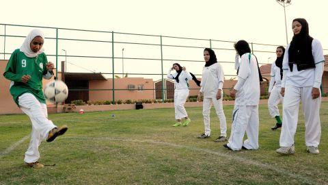 Saudi members of the King's United women's football club train at a stadium in Jeddah.