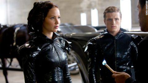 Katniss Everdeen (Jennifer Lawrence, left) and Peeta Mellark (Josh Hutcherson) before a fiery debut at the Hunger Games.