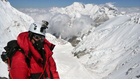 Dellis climbs Mt. Everest in May 2011. Through his charity, he climbs mountains to raise money for Alzheimer's disease research.