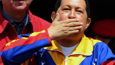 Venezuelan President Hugo Chavez blows a kiss to supporters from the presidential palace in Caracas on March 17, 2012.