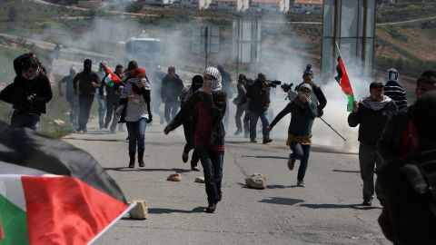 Tear gas on Friday scatters Palestinians protesting the seizure of land for a Jewish settlement near Ramallah in the West Bank.