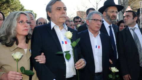 Gilles Bernheim, Great Rabbi of France (2nd from right), and others march on March 25 in Toulouse, France where three Jewish children and their teacher were killed.