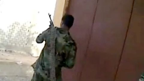 A YouTube video purported to be from Sabha, Libya, shows men shooting from behind a corner.