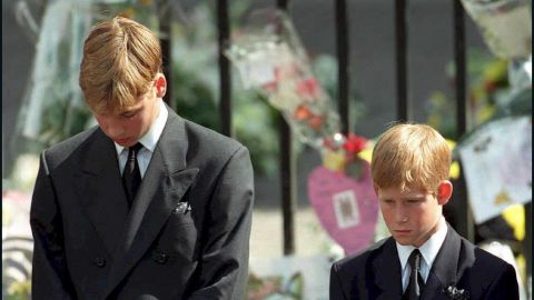 Prince William, left, and Prince Harry bow their heads as their mother's coffin is carried out of Westminster Abbey in September 1997.