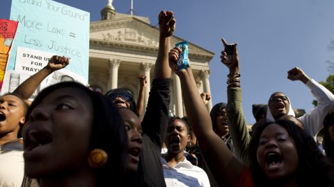"""Thousands of protesters gathered at the """"I am Trayvon Martin"""" rally Monday at the state Capitol in Atlanta. Protesters wore hoodies and carried containers of iced tea and bags of Skittles."""