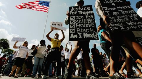 Trayvon Martin supporters march through downtown Sanford, Florida, on Monday, March 26, before the start of a town hall meeting about Martin's death. Exactly one month ago, the 17-year-old was shot dead while walking home from a convenience store, where he'd picked up a bag of Skittles and an iced tea.