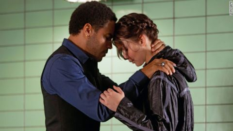 """Lenny Kravitz plays Katniss' stylist Cinna in """"The Hunger Games."""" In the novel, Cinna is described as having short brown hair."""
