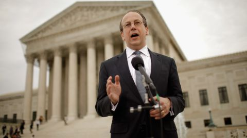 Paul Clement, who is arguing for the states over new Medicaid requirements, speaks outside the court Wednesday.