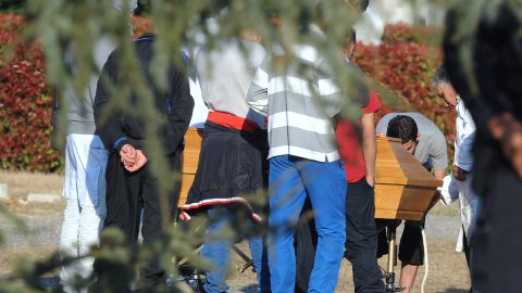 Relatives of Islamist extremist Mohamed Merah attend the burial of his body in a Toulouse cemetery.