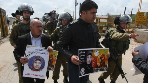 Israeli troops try to disperse Palestinians demonstrating outside a prison near Ramallah in support of Hana Shalabi.