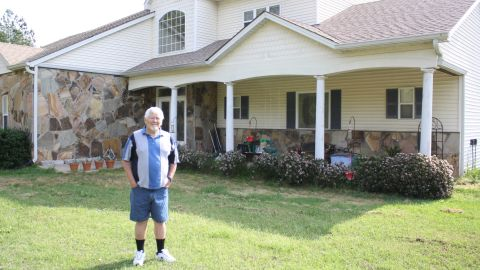 Robert Maddox of Juliette, Georgia, poses on his property. Maddox says Georgia Power expressed interest in buying his property after leveling the house next door and sealing the water well.