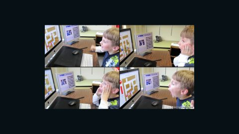 Jesse Wilson, 8, plays a game called FaceMaze at the autism center Joseph Sheppard co-directs at the University of Victoria.