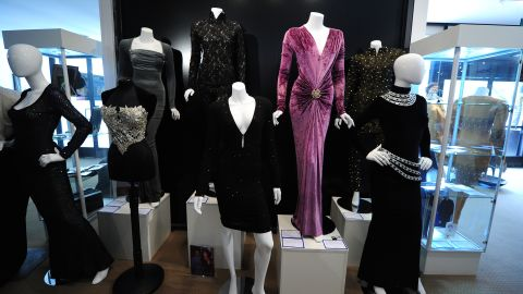 A collection of dresses worn by Whitney Houston stands on display Friday ahead of an auction in Beverly Hills, California.