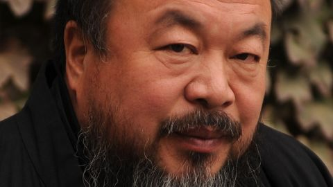 (FILES) This file picture taken on November 7, 2010 shows Chinese artist Ai Weiwei in the courtyard of his home in Beijing where he was under house arrest. Chinese artist and activist Ai Weiwei is reuniting with the Swiss architects with whom he created Beijing's spectacular Bird's Nest Stadium, to build a pavilion for this year's London Olympics. Ai, along with the Swiss firm Herzog and de Meuron, will join forces again to design a pavilion for the Serpentine Gallery in London's Kensington Gardens park, the gallery said on February 7, 2012. AFP PHOTO / FILES / Peter PARKS (Photo credit should read PETER PARKS/AFP/Getty Images)