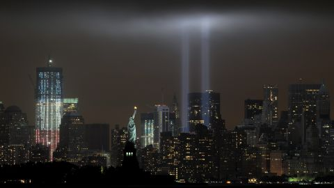 """Stephen Cox believes 9/11 is the only catastrophe with enough stories of courage, resilience, and tragedy to live on in memory like that of the Titanic.  Here, the """"Tribute in Light"""" memorial illuminates the sky with ghosts of the World Trade Center's twin towers on the 10th anniversary of the terror attacks."""