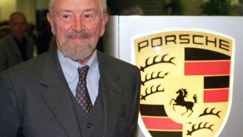 Picture from January 22, 1999 shows Ferdinand Alexander Porsche next to the logo of German car maker Porsche in Stuttgart.