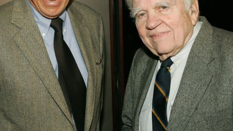 """Wallace and and fellow """"60 Minutes"""" correspondent Andy Rooney attend a 2005 screening of """"Enron: The Smartest Guys in the Room"""" in New York."""