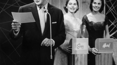 """Wallace, as host, reads a question in this production still from the 1956 quiz show, """"Big Surprise."""""""