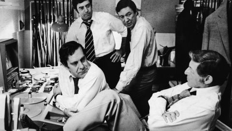 """""""60 minutes"""" correspondents Morley Safer, from left, Dan Rather and Mike Wallace, and executive producer Don Hewitt, right, discuss upcoming segments during the 1970s."""