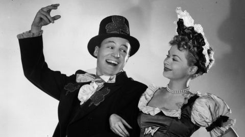 """Wallace and his then-wife, Buff Cobb, dressed in costume for a 1952 St. Patrick's Day episode of their CBS show, """"Mike and Buff."""" The newsman was a communications officer in the U.S. Navy during World War II before landing a series of television jobs in Chicago and trying his hand at acting."""