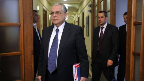 Greek Prime Minister Lucas Papademos arrives for the cabinet meeting at the Greek Parliament in Athens on April 11, 2012.