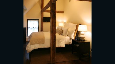 Wood beams from the building's original structure, dating back to the 18th century, have been retained.