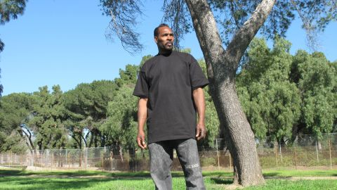 Rodney King poses near the site of his 1991 beating by police officers in Lake View Terrace, California.
