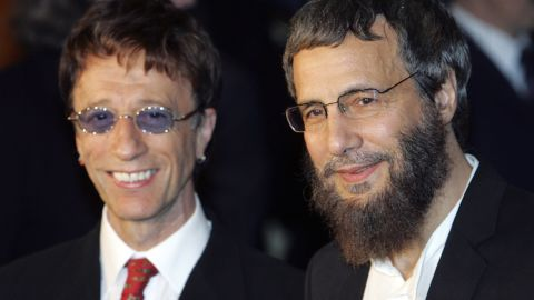 """Yusuf Islam (formerly Cat Stevens) and Robin Gibb arrive at the """"Adopt-A-Minefield"""" benefit gala in support of landmine victims in 2005 in Neuss, Germany."""