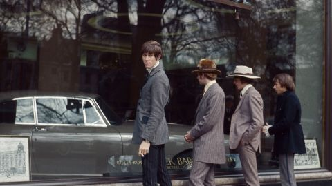 The Bee Gees, formerly known as The Brothers Gibb, pose in front of a Rolls Royce showroom in 1967.
