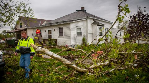 Emergency personel go house to house checking on residents after the tornado on Saturday in Thurman.