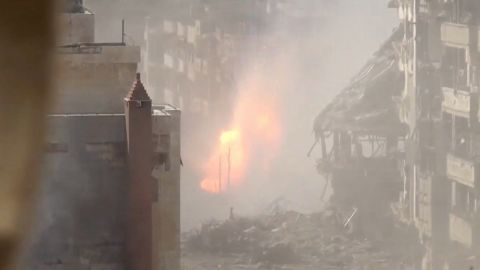 Still taken from YouTube video purports to show fresh shelling in Homs during U.N. cease-fire.