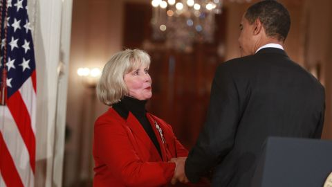 JANUARY 29: U.S. President Barack Obama walks with Lilly Ledbetter into the East Room before signing the 'Lilly Ledbetter Fair Pay Act during an event at the White House January 29, 2009 in Washington, DC. The The Lilly Ledbetter Fair Pay Act was recently passed by congress granting equal pay to all women.
