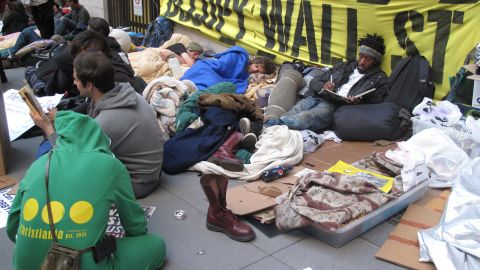 Occupy Wall Street supporters have moved their protests to sidewalks.