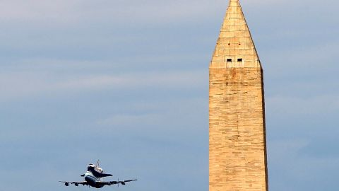 Space shuttle Discovery, mounted atop a 747 shuttle carrier aircraft, goes by the Washington Monument during a flyover of the nation's capital on its trip to retirement Tuesday, April 17. The flight -- the last time Discovery will be aloft -- took it from Florida's Kennedy Space Center to the Washington area, where it will spend retirement as a museum piece at an annex to the Smithsonian National Air & Space Museum in Chantilly, Virginia, near Dulles International Airport.