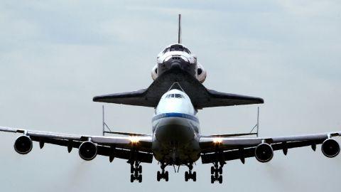 The 747 shuttle carrier aircraft, carrying Discovery, prepares to land at Washington Dulles International Airport on Tuesday in Chantilly, Virginia.
