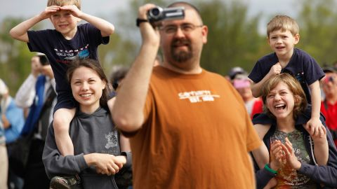 Spectators watch as Discovery passes over the Steven F. Udvar-Hazy Center on Tuesday.