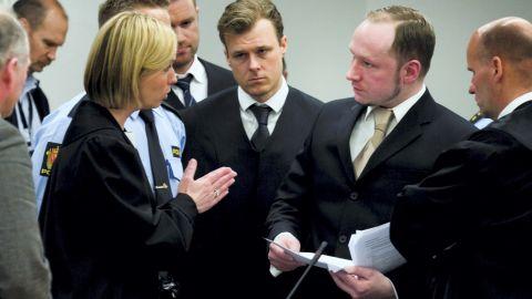 State prosecutor Inga Bejer Engh (L) speaks with Anders Behring Breivik (2nd R) on second day of Breivik's trial.