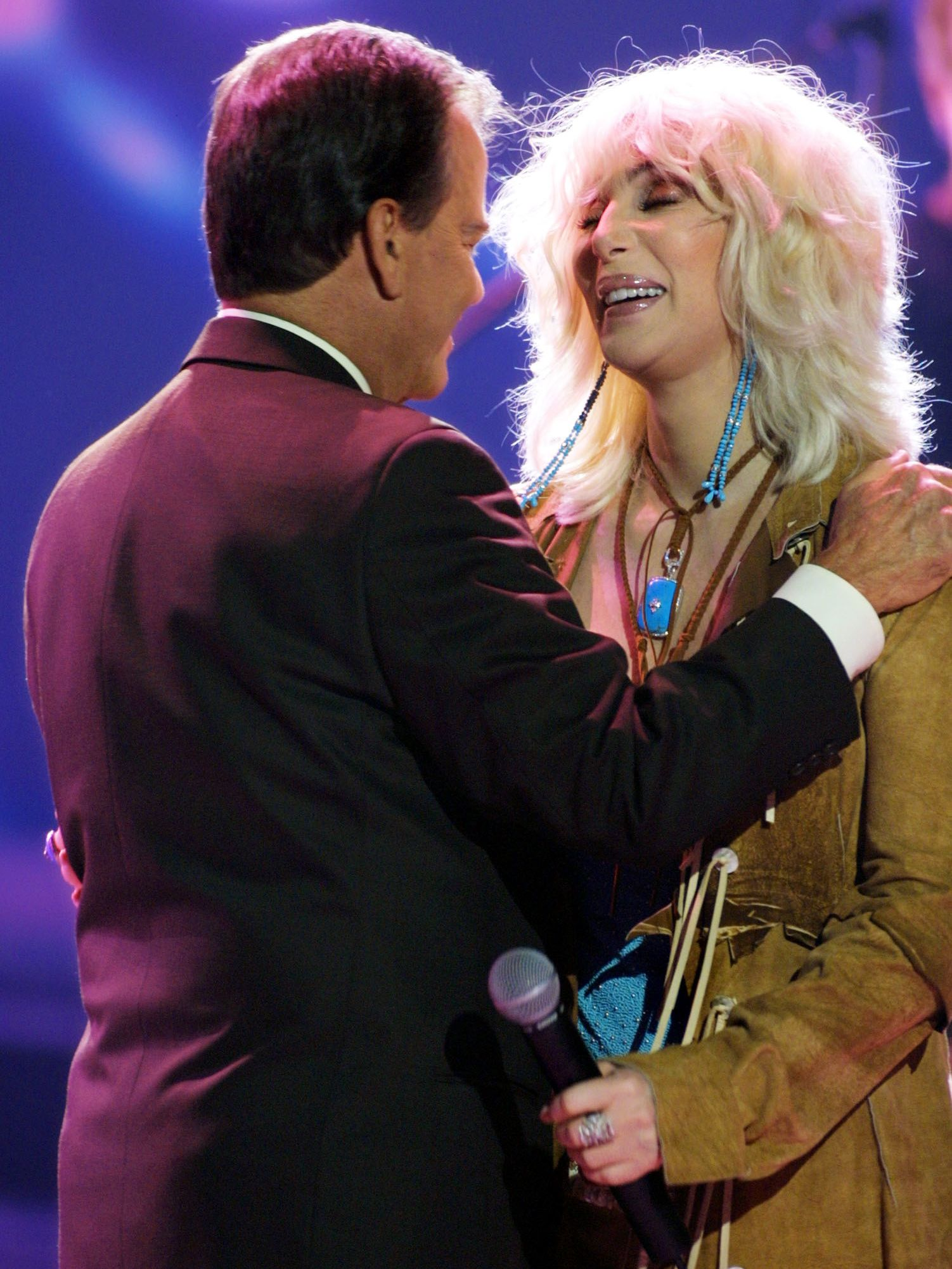 """Clark and Cher hug during the taping of the 50th anniversary speical of """"American Bandstand."""""""