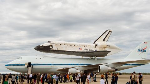 The final journey of space shuttle Discovery as it is strapped to the top of a Boeing 747 Shuttle Carrier Aircraft. Landing in Washington on April 17, 2012 to be placed in the Smithsonium's National Air and Space Museum. It signals the lack of public funding and the emergance of private firms entering space exploration.