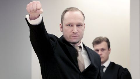 Anders Behring Breivik extends a clenched fist on Tuesday in Oslo, Norway, for the second day of his trial.
