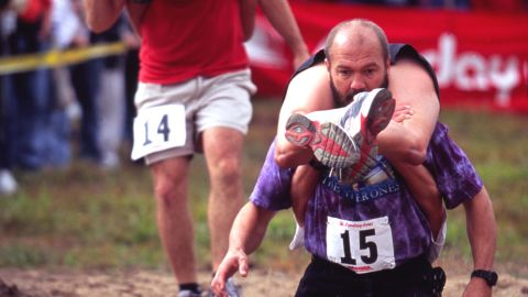 """Those looking for a shorter race might be interested in the <a href=""""http://www.sundayriver.com/Events/Main/Summer/Wife_Carrying_Championship.html"""" target=""""_blank"""" target=""""_blank"""">Wife Carrying Championship</a> held at the Sunday River ski resort in Maine during Fall Festival Weekend. The 278-yard dash is usually won by a couple using the """"Estonian carry,"""" seen here."""