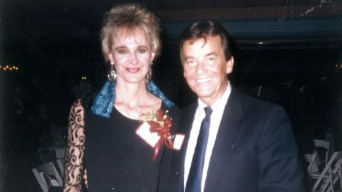 """Sioux Falcone, who worked with Clark in Los Angeles, posed with him at a 1980s holiday party. """"I pulled out the photo yesterday and here he is, wearing his name,"""" Falcone said. """"I thought it was really endearing, and everyone had a name tag on, so I am sure he thought that he needed to do it, too."""""""