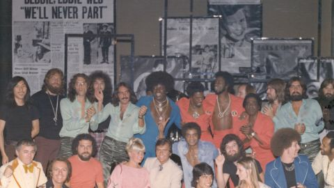 """Drummer Bill Rodriguez was among those who posed for this large group photo with Clark for his Las Vegas show in the 1970s. Rodriguez admitted to a mistake in one of the performances: """"I was so nervous I launched into the 'Bandstand' theme all by myself before Dick's monologue, leaving Dick alone on the stage with a mic while I played by myself before realizing I'd just massively blown it. Dick just told the audience, 'Ah, the enthusiasm of youth,' and made it seem as if it was part of the show. """""""