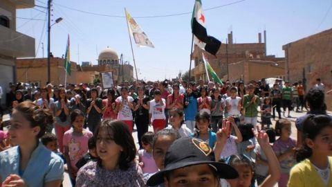 Syrians rally against the regime in the city of Qamishli on April 20, 2012.