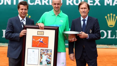 """ATP chief Brad Drewett (L) and director Zeljiko Franulovic present the Croatian with a special trophy and gift to mark his retirement from tennis. Drewett described Ljubicic as """"a true gentleman and ever popular amongst his peers."""""""