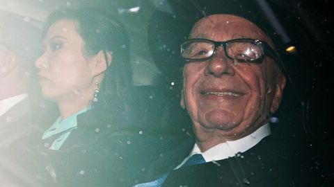 News Corp Chief Rupert Murdoch, (R) and his wife Wendi Deng leave their London home, on April 25, 2012, as Rupert Murdoch prepares to give evidence at the Leveson Inquiry.