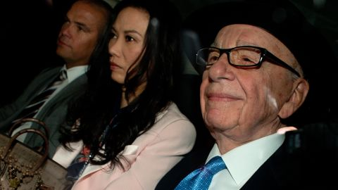 Rupert Murdoch (R) his wife Wendi Deng (C) and son Lachlan (L) leave their London home on April 26.