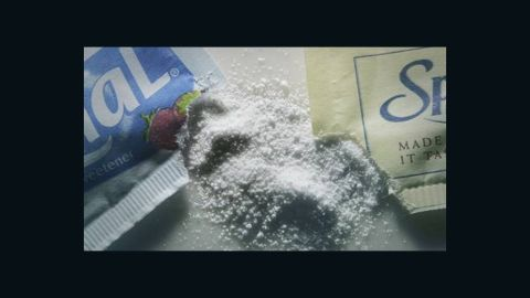 """Equal and NutraSweet are FDA-approved artificial sweeteners made from aspartame (two amino acids put together). Another artificial sweetener, <a href=""""http://www.splenda.com/faq/no-calorie-sweetener"""" target=""""_blank"""" target=""""_blank"""">Splenda</a>, is sucralose-based and is created from chemically processed sugar. According to <a href=""""http://www.cnn.com/2013/07/15/health/artificial-sweeteners-soda/"""">researchers</a>, one possible risk of digesting these products is that it can confuse your body, making it harder to process real sugars as a result. Calories per tablespoon: 0."""