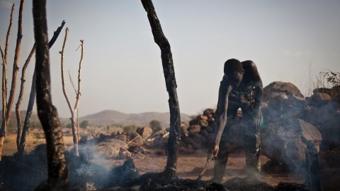 A man looks through the remains of a house destroyed by an airstrike in Tabanya, South Kordofan, on April 26.