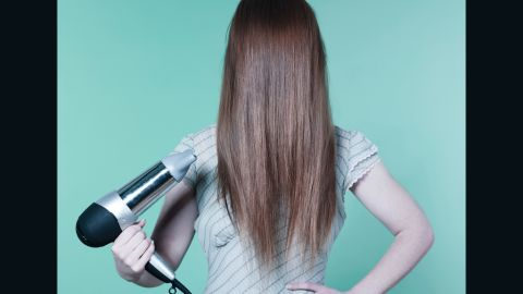 Hair should be about 80% dry before pulling it up to avoid breakage.
